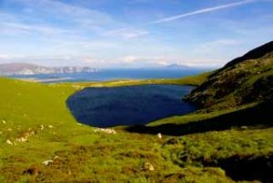 Achill Island showing lake and sea.